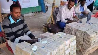 这个国家穷得只剩钱 多到论斤称小偷只偷吃的