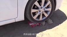 为了测试轮胎质量!老外把斧头放在汽车轮下,轮胎能坚持多久?