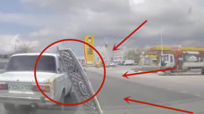 身后突然冲出不速之客,车前盖被撞司机心寒!