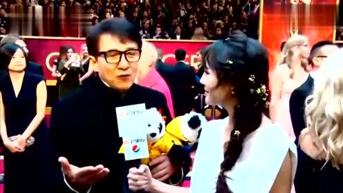 奥斯卡红毯:成龙接受采访看到碧昂丝变迷弟,跑上前拥抱热吻