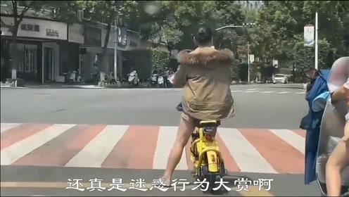 搞笑视频:夏天穿羽绒服,美女,大热天你不冷