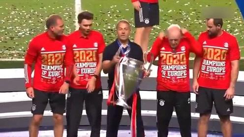神奇主帅弗里克教练组赛后高举欧冠奖杯