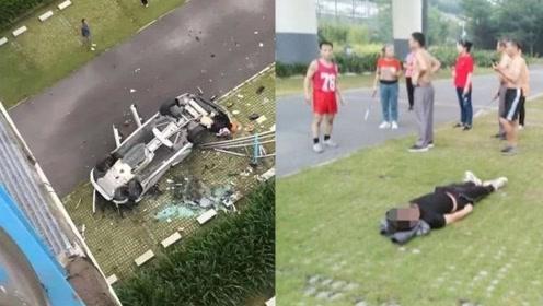 刚刚!宝马车冲出护栏从20米高大桥坠落,司机被救出后躺地上睡觉