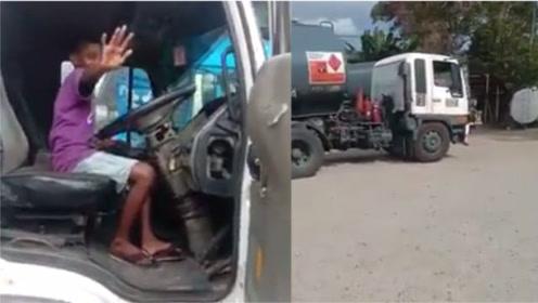 马来西亚12岁男孩被拍到独自驾驶油罐车倒车 其父母最高可判10年监禁