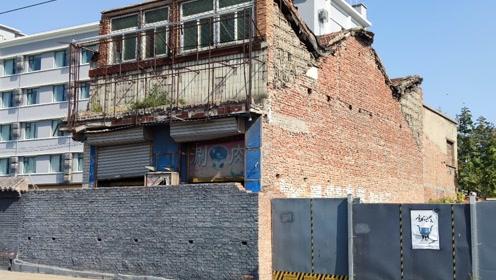 北京天安门旁边的钉子户,价值上亿的破房子,为什么一直没人敢拆?