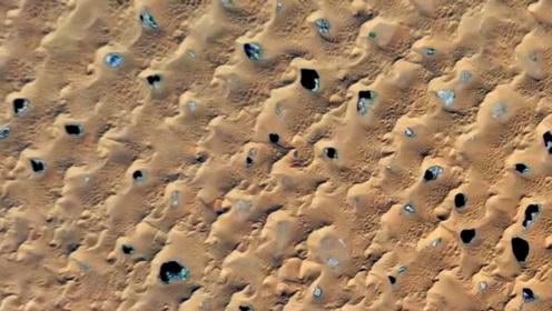 """美国卫星路过中国沙漠,发现""""神秘小黑点"""",引起科学家高度重视"""