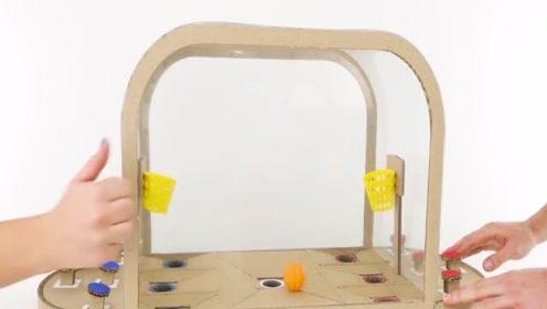 如何用硬纸板制作两人篮球板游戏。