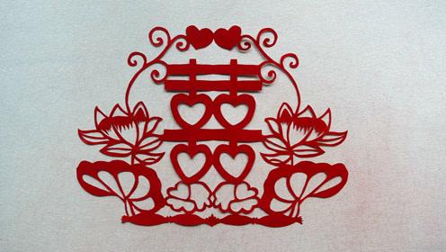 荷花喜花剪纸,荷花图案把爱心双喜包围在中间,很喜庆哟!