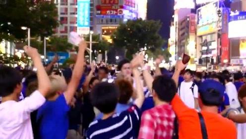日本队击败哥伦比亚,创造亚洲历史,赛后日本球迷冲上街头庆祝