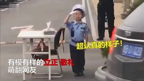 小朋友替爷爷上班变身萌萌小保安,看到车来认