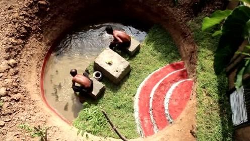 建造最具创意的泥别墅,包括地下卧室和泥屋前的鱼塘。