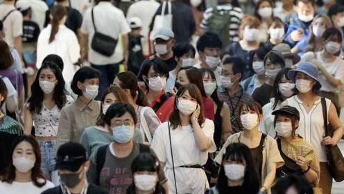 日本新冠患者累计破6万:连续14天日增破千例,
