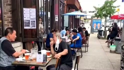 为了防止疫情反弹,纽约的餐馆至今未开放堂食,路边大排档成了亮丽的风景线