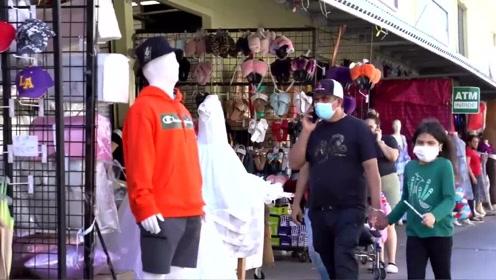 街头恶搞:门店前的男模突然复活,吓得路人纷