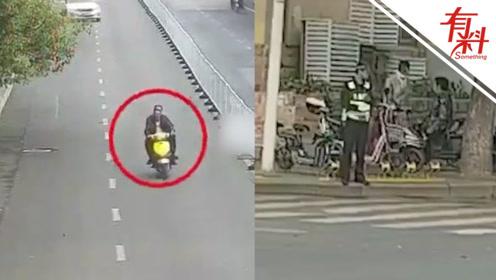 男子骑摩托车载人 一不小心摔倒在民警面前结局亮了