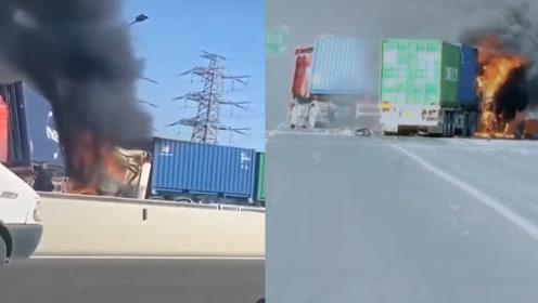 上海高速匝道6辆集卡相撞后起火,一人被困车内