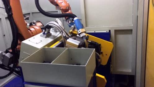 汽车减震器机器人自动焊接工作站工作过程